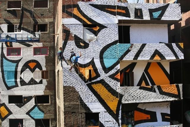 """""""السيد"""" يبدع في آخر عمل غرافيتي له في القاهرة"""